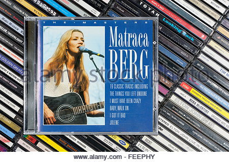 Matraca Berg greatest hits album, piled music CD cases, Dorset England - Stock Photo