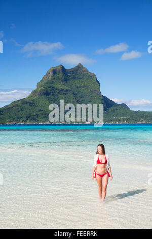 Woman on Motu Tapu, Bora Bora, Society Islands, French Polynesia - Stock Photo