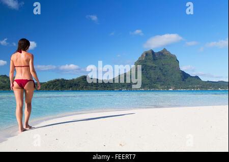 Woman on Motu Tapu, Bora Bora, Society Islands, French Polynesia (MR) - Stock Photo