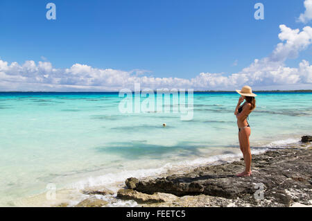 Woman on beach, Fakarava, Tuamotu Islands, French Polynesia - Stock Photo