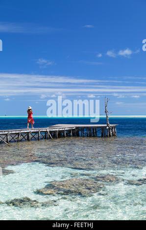 Woman on jetty, Tetamanu, Fakarava, Tuamotu Islands, French Polynesia - Stock Photo