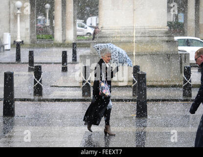 Weather.Southport,Merseyside,UK. January 30th 2016. A  showery wet afternoon with some hail showers. A women uses - Stock Photo