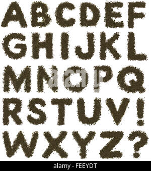 Full alphabet made of brown soil on white background - Stock Photo