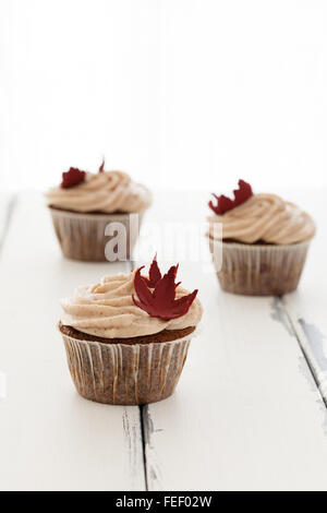 thee cupcakes on vintage background - Stock Photo
