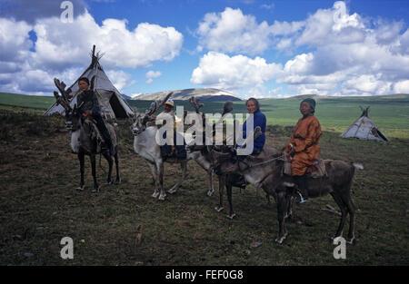 Duhkha (same as Tsaatan) people riding their reindeer - Stock Photo