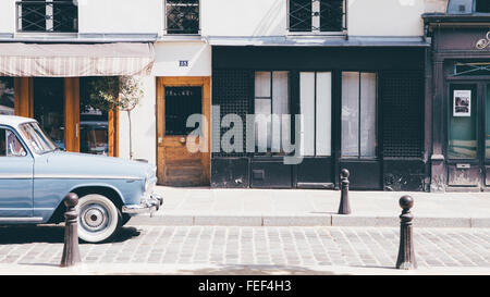 Old car in parisian street - Stock Photo
