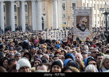 Vatican City, Vatican. 06th Feb, 2016. A faithful holds a portrait of Padre Pio as he gather in St. Peter's Square - Stock Photo