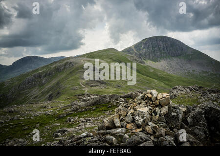 From the summit of Brandreth looking toward Green Gable then Great Gable behind then scafell pike in the very distance. - Stock Photo