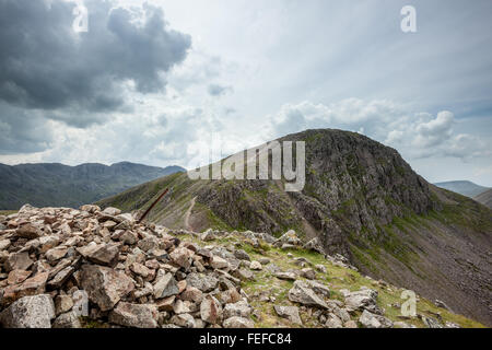 Looking across to Great Gable from the summit of Green Gable with Scafell Pike in the distance - Stock Photo