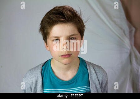 10 year old boy looking sad, child - Stock Photo