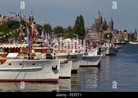 SAIL Amsterdam. Boats and ships in harbour. Flags and masts. Holland and Netherlands - Stock Photo