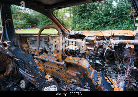 Inside of an abandoned fire damaged car - Stock Photo