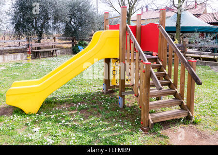 Facilities for children in an outdoor playground. - Stock Photo