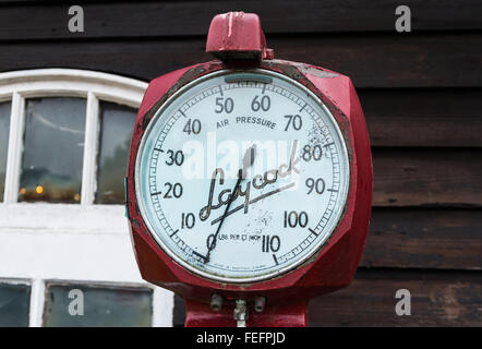 Vintage Laycock air / tyre pump and pressure gauge on display at the Battlebridge Motorcycle Museum, Essex UK. - Stock Photo
