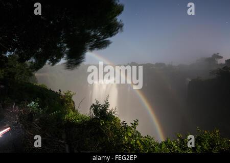 Lunar rainbow at Victoria falls - Stock Photo