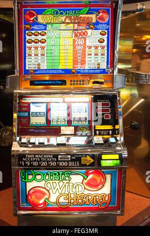 Slot machines in casino on board Royal Caribbean 'Brilliance of the Seas' cruise ship, Mediterranean, Europe - Stock Photo