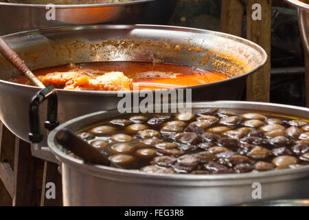 Thai street food for sale on a stall in Bangkok Thailand - Stock Photo