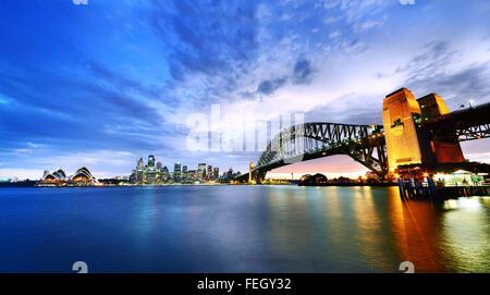 Sydney Harbor Panorama at twilight - Stock Photo