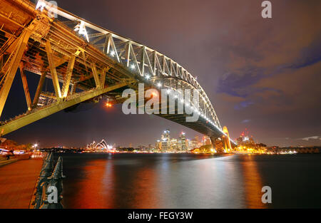 Sydney Skyline and Harbor Bridge at night - Stock Photo