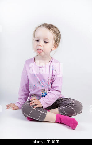little girl showing tongue - Stock Photo