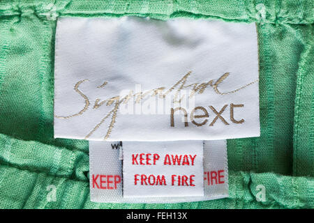Signature Next keep away from fire label in clothing - Stock Photo