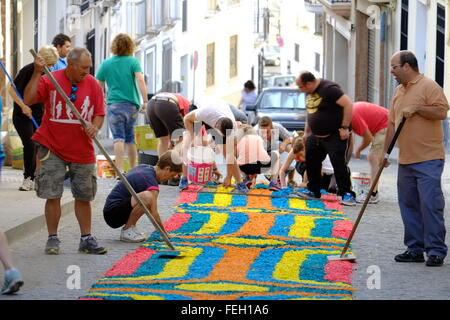 Corpus Christi. Carpets of colour dyed sawdust are laid though the town. Later a religious procession happens. Carcabuey, - Stock Photo