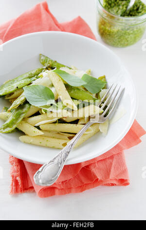 spring pasta with green peas, food closeup - Stock Photo
