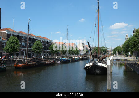 Wooden Dutch sailing barges in the harbour waterfront at Delfshaven, Rotterdam, Netherlands - Stock Photo