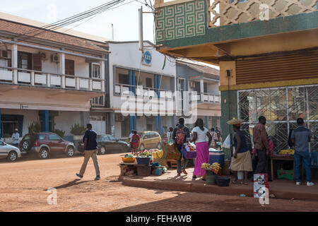 A street with market traders in the Guinea Bissau capital city of Bissau - Stock Photo