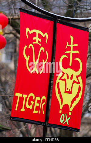 Art & artwork on Happy  New Year decorations, hanging banners. Chinese character phase to signify good fortunes. - Stock Photo