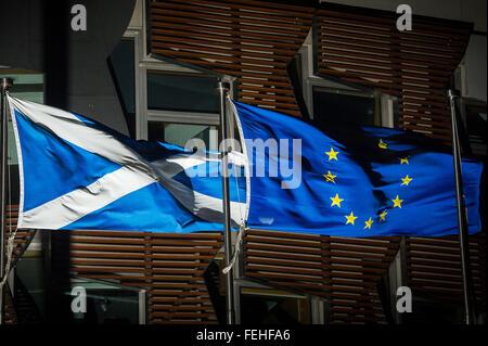 Edinburgh, Scotland, UK. 7th February, 2016. The Saltire and the European Union flag fly outside the Scottish Parliament. - Stock Photo