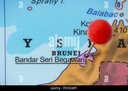 Close-up of a red pushpin in a map of Bandar Seri Begawan, Brunei. - Stock Photo