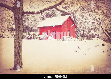 Retro style image of red barn in winter with snow and trees. this image has a vintage texture effect. - Stock Photo