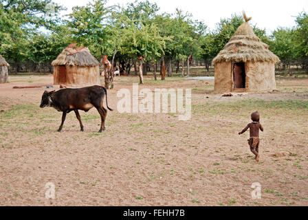 Himba village with traditional hut near Etosha National Park in Namibia, Africa - Stock Photo