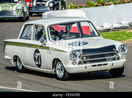 1964 Ford Lotus Cortina Mk1 is owned by Kerry Michael and was raced by Mark Blundell at the 2015 Goodwood Revival. - Stock Photo