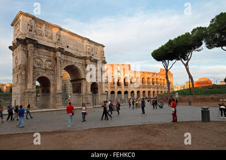 The Arch of Constantine and the Colosseum in Rome, Italy; Arco Di Constantino, Colosseo, Roma - Stock Photo