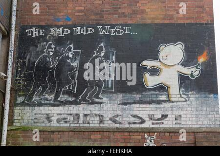 April 2014 - Bristol, United Kingdom: A graffiti of Banksy called The Mild Mild West, of a bear with fire in his - Stock Photo