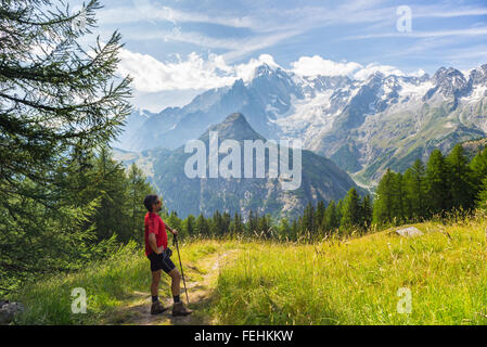 Hiker resting in front of the majestic Mont Blanc massif (4810 m) and his melting glaciers. Summer adventures in - Stock Photo