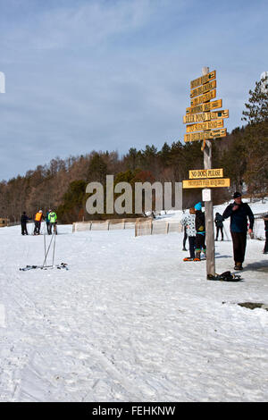 The Von Trapp Family Lodge in Stowe Vermont, USA, cross country skiers  on groomed trails with trail marker. - Stock Photo