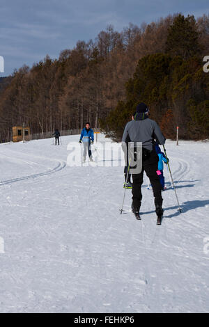 The Von Trapp Family Lodge in Stowe Vermont, USA,  cross country skiers  on groomed trails. - Stock Photo