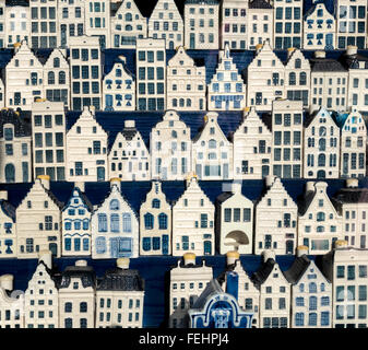 Amsterdam a display of delftware miniature Dutch canal houses in an antique shop. KLM souvenirs that originally - Stock Photo