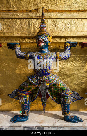 Yaksha Guardians at Wat Phra Kaew, regarded as the most sacred temple in Thailand located inside the grounds of - Stock Photo