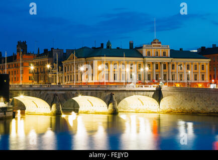 Night View Of Illuminated Old Norrbro Bridge in Stockholm, Sweden - Stock Photo