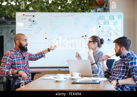 Multiethnic group of business people working together in office - Stock Photo