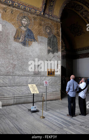 Tourists in front of The Deesis mosaic with Christ as ruler, in Hagia Sofia, Istanbul, Turkey on May 3, 2015. - Stock Photo