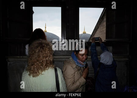 Tourist take pictures from a window in Hagia Sophia, Istanbul, Turkey on May 3, 2015 - Stock Photo