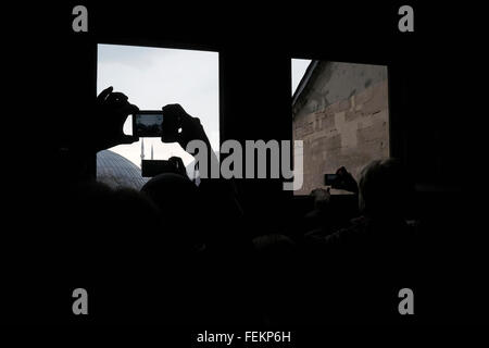 Tourist take pictures from a window in Hagia Sophia, Istanbul, Turkey on May 3, 2015. - Stock Photo