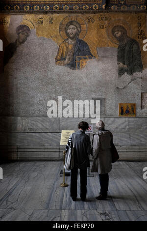 Tourists in front of The Deesis mosaic with Christ as ruler, Hagia Sofia, Istanbul, Turkey on May 3, 2015. - Stock Photo