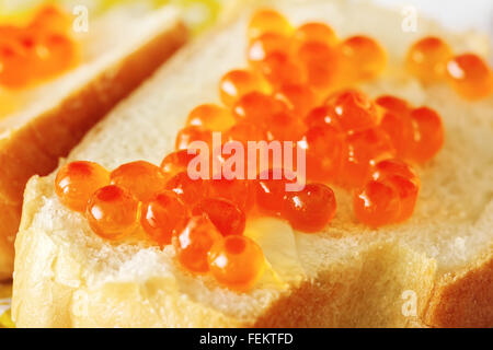 Sandwich of white bread with red caviar - Stock Photo