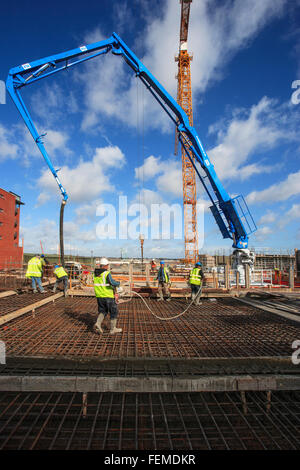 construction workers pouring concrete - Stock Photo